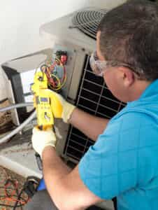 HVAC technician testing AC unit