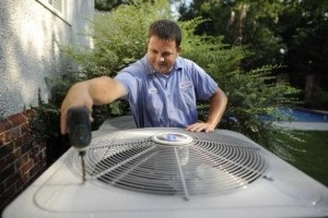 man fixing an air conditioner