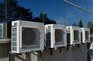 4 air conditioning units on a wall