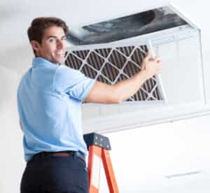 AC technician changing air filter