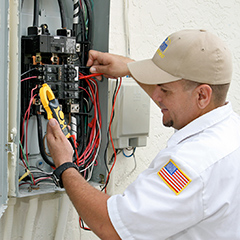 man fixing electrical wires