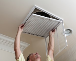 Man removing air filter