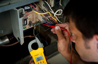 Service professional checking wiring