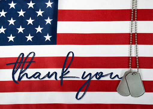 "American flag and dog tags with the words ""thank you"""