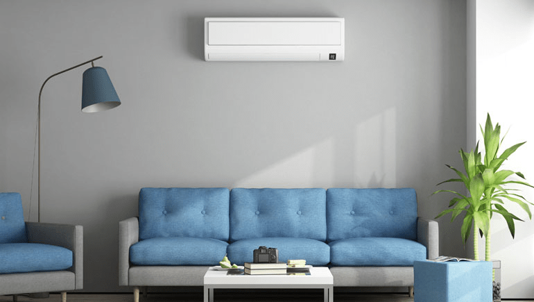 Ductless AC Unit over blue couch